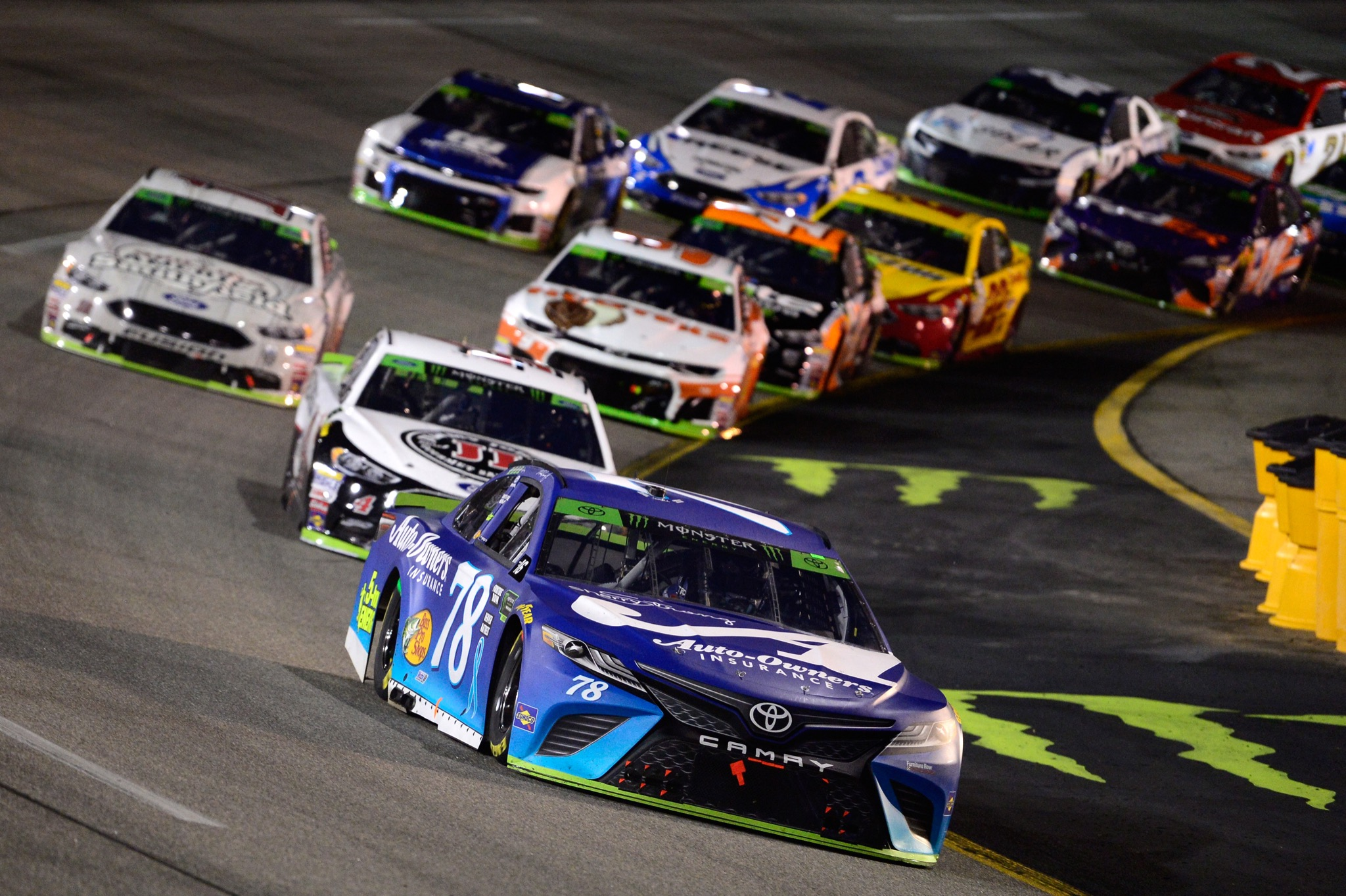 Martin Truex Jr. leads a pack of cars during the Monster Energy NASCAR Cup Series Federated Auto Parts 400 at Richmond Raceway on September 22, 2018 in Richmond, Virginia.