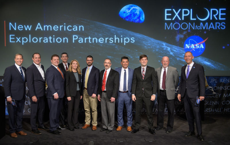 NASA Administrator Jim Bridenstine (left) and Associate Administrator Thomas Zurbuchen (right) are shown to representatives of the nine US companies that can provide NASA delivery services to the lunar surface.