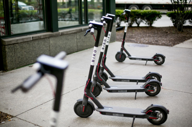 A row of parked electric scooters.