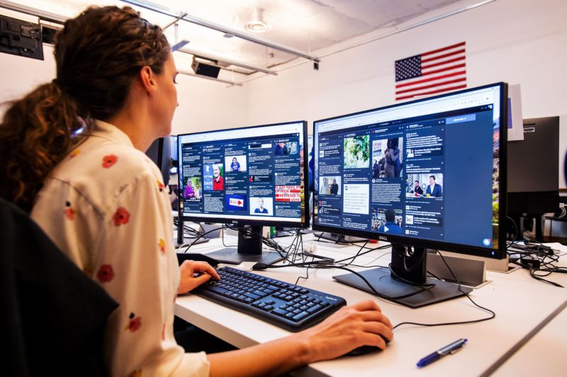 "War room leader for Brazil elections Lexi Sturdy works in Facebook's ""War Room"" during a media demonstration on October 17, 2018, in Menlo Park, California."