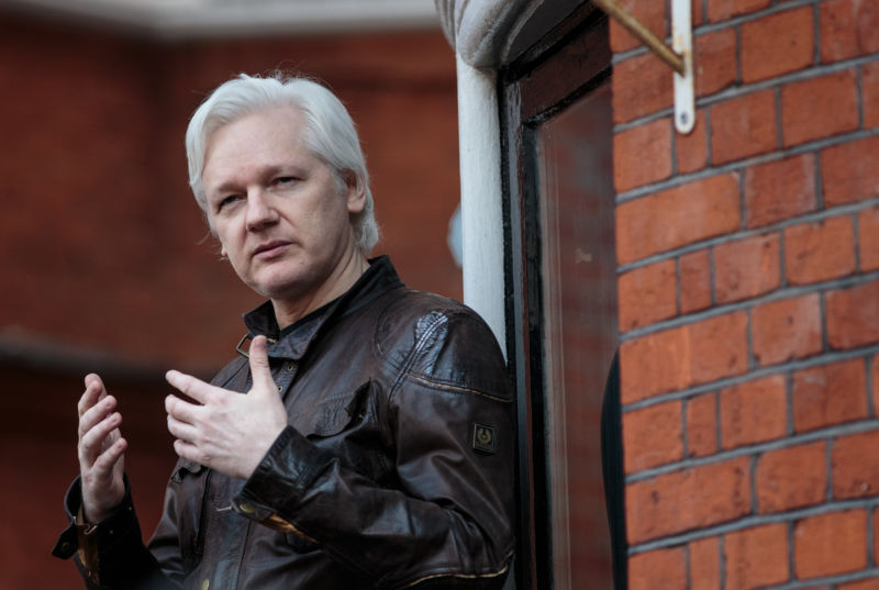 Julian Assange gesturing with his hands as he speaks to the media from the balcony of the Embassy of Ecuador on May 19, 2017 in London, England.