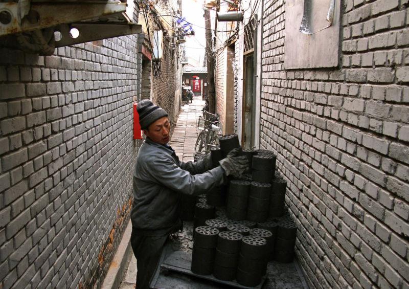 Vendor delivering coal briquettes