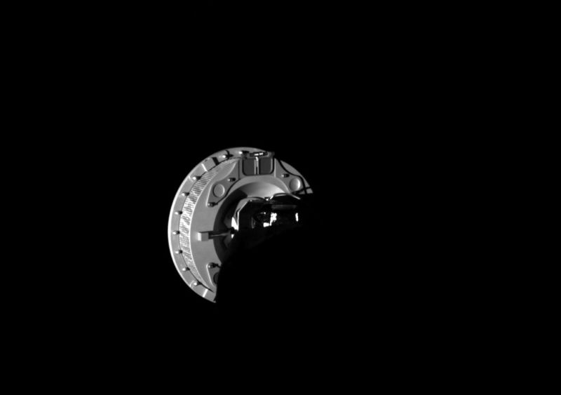 This image, taken Wednesday, shows the OSIRIS-REx Touch-and-Go Sample Acquisition Mechanism sampling head extended from the spacecraft at the end of the robotic arm.