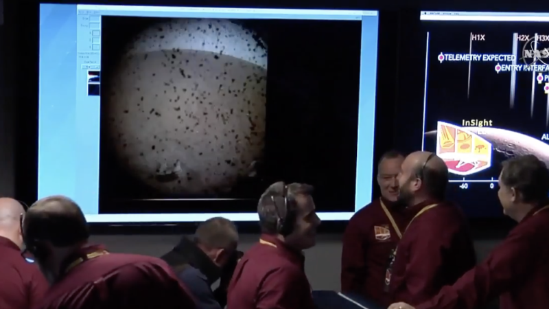 Staff at the Jet Propulsion Lab celebrate as InSight sends its first picture down from Mars.