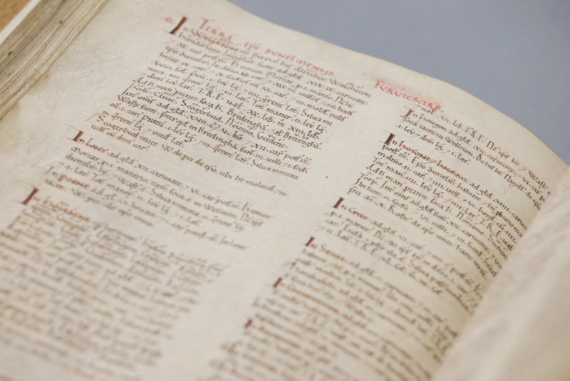 Original manuscript of the Domesday Book on display at The National Archives in Kew, London. Satellite documents preserved by a Benedictine abbot named Nigel place its completion date much later than previously assumed.