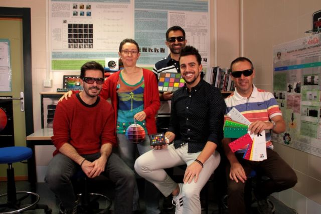 The University of Granada research team posing with EnChroma glasses.