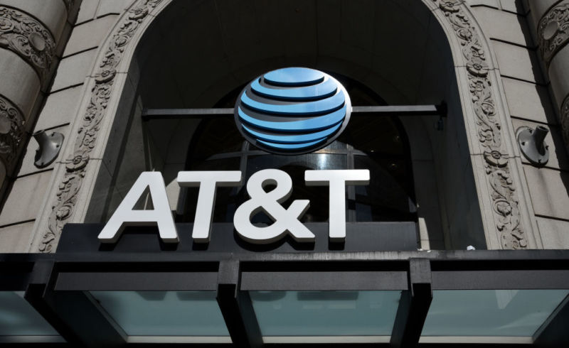 An AT&T logo above the entrance to an AT&T store.