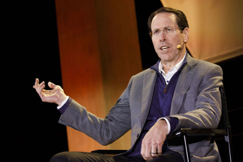 AT&T CEO Randall Stephenson speaking and gesturing with his hand while being interviewed at a tech conference.
