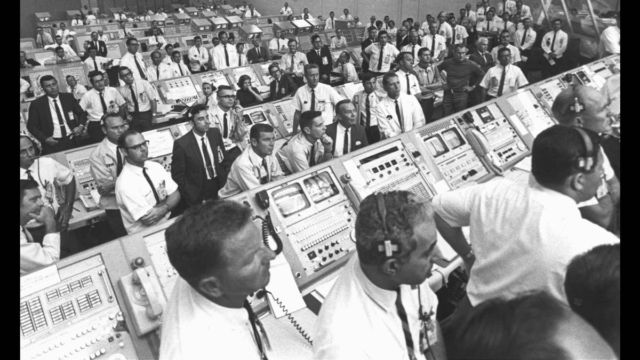 The unsung heroes of Apollo 11. Inside the Launch Control Center, personnel watch as the Saturn V rocket carrying the astronauts lifts off.