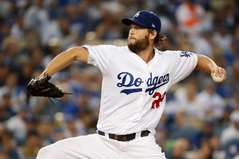 Los Angeles Dodgers pitcher Clayton Kershaw delivers the pitch during the first inning against the Boston Red Sox in Game Five of the 2018 World Series at Dodger Stadium.