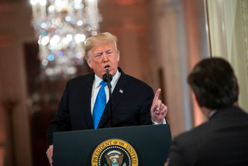 President Donald Trump at a press conference, pointing his finger and talking to CNN journalist Jim Acosta.