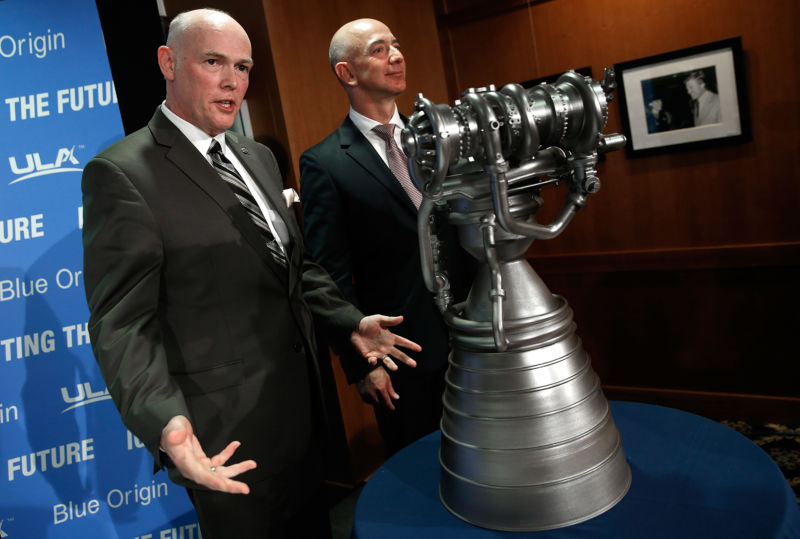 Jeff Bezos (right), the founder of Blue Origin and Amazon.com, and Tory Bruno, CEO of United Launch Alliance, display the BE-4 rocket engine during a press conference in 2014.