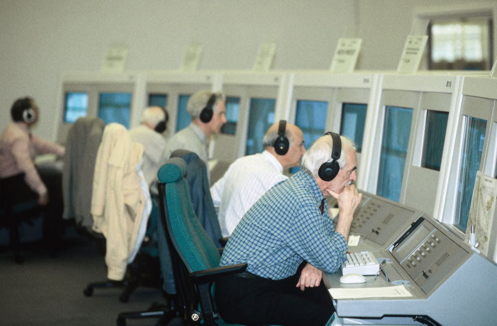Air traffic controllers at the NATS London Area Control Centre LACC in Swanwick, UK. Heavily accented English over noisy communications channels is a real test of AI voice recognition.