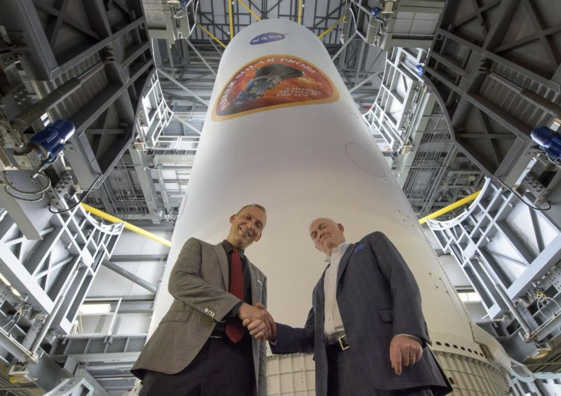 NASA Associate Administrator for Science Thomas Zurbuchen, left, and President and CEO for United Launch Alliance Tory Bruno shake hands after viewing the ULA Delta IV Heavy rocket with NASA's Parker Solar Probe in August.