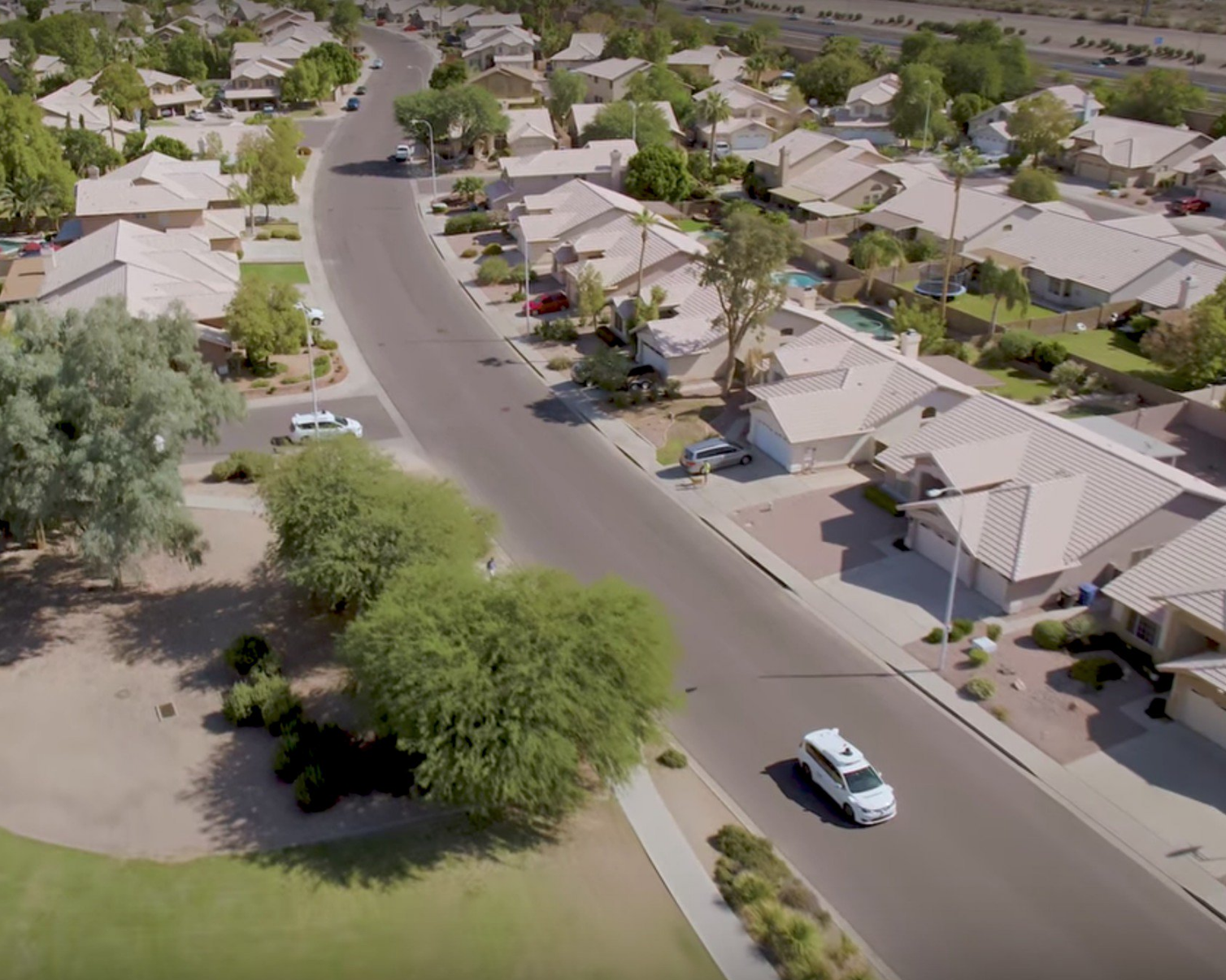 "This is a screenshot from Waymo's <a href=""https://www.youtube.com/watch?v=aaOB-ErYq6Y"">November 2017 video</a> announcing the start of fully driverless testing. It shows fully driverless Waymo cars driving on residential streets that are almost empty."