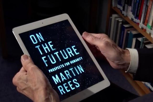 Renowned cosmologist Martin Rees holds the electronic version of his latest book, <em>On the Future</em>.