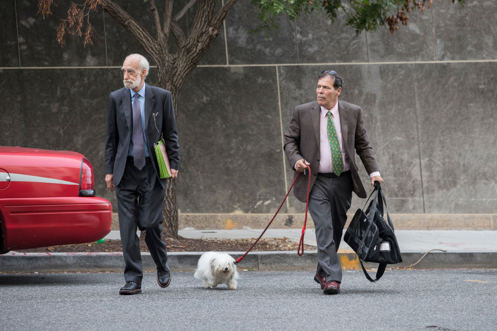 WASHINGTON, DC - SEPTEMBER 7: Randy Credico (R) and his dog Bianca arrive at U.S. District Court, September 7, 2018 in Washington, DC. Credico, a comedian with ties to Roger Stone, was subpoenaed by special counsel Robert Mueller and eventually testified before the grand jury.(Photo by Drew Angerer/Getty Images)