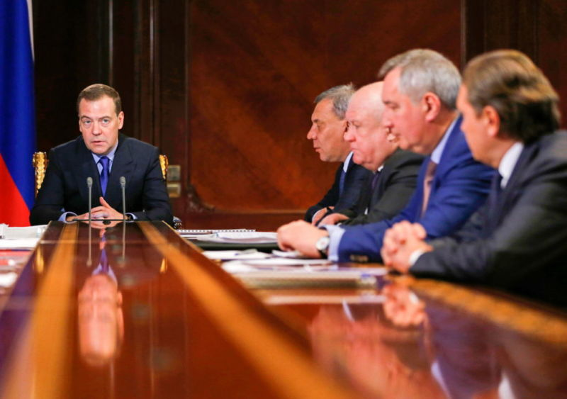 Russia's Prime Minister Dmitry Medvedev (L) during a meeting on the financial and economic condition of the Roscosmos State Corporation on Wednesday.