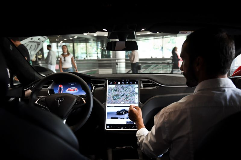 A seller shows the dashboard of the Tesla Model S car at the electric carmaker Tesla showroom of El Corte Ingles store in Lisbon, on September 1, 2017.