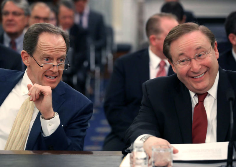 Barry Lee Myers (R) sits with Sen. Pat Toomey (R-PA) (L), during his Senate Commerce, Science and Transportation Committee confirmation hearing to lead NOAA in 2017.