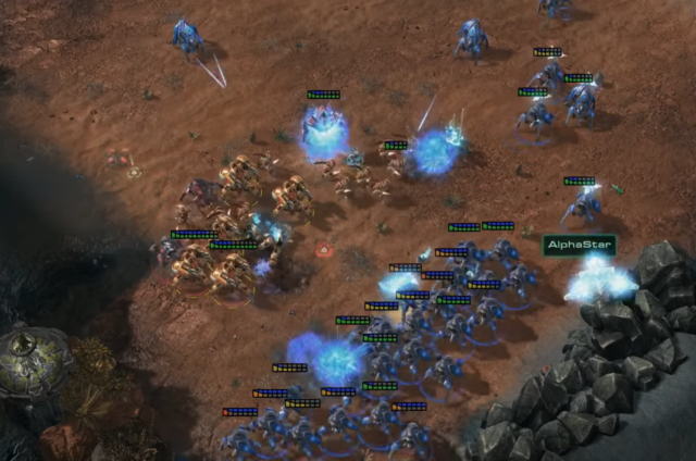 In this scene from Game 4 of the AlphaStar v. Komincz series, AlphaStar's Stalkers (blue) attack Komincz's Immortals, Archons, and Zealots (red) on three sides. AlphaStar's Stalkers ultimately won this battle and went on to destroy Komincz's base.