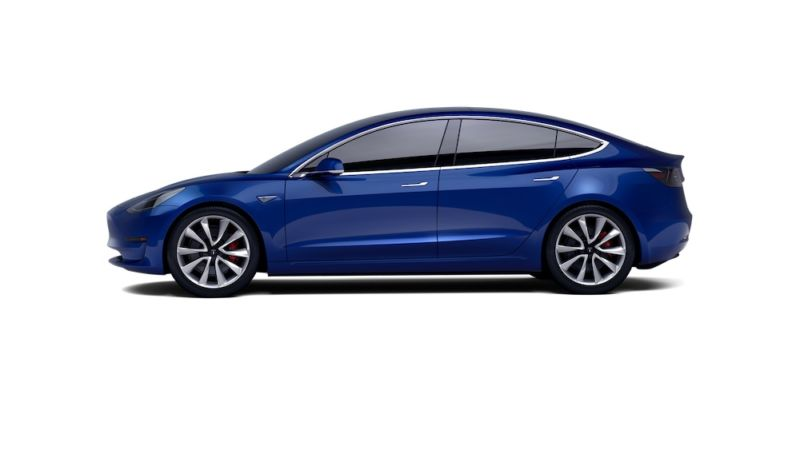 Image of a blue sedan against a white background.