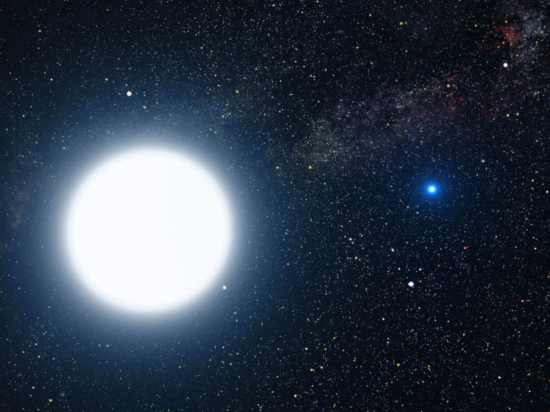 An artist's impression showing the binary star system of Sirius A and its diminutive blue companion, Sirius B.