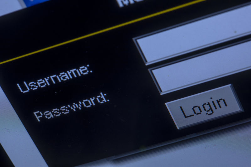 The query window for username and password on a Web page can be seen on the monitor of a laptop.