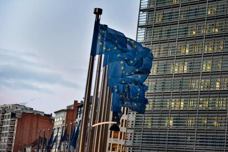 European flags wave in front of the Berlaymont building—the European Commission (EC) headquarter—in Brussels, Belgium. EC commissioners have cited a lack of progress by Google, Facebook, and Twitter on measures to stop disinformation operations associated with European elections.