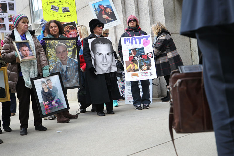 BOSTON, MA - JANUARY 25: Families who have lost loved ones to the opioid crisis protest in front of Suffolk Superior Court in Boston as lawyers for Purdue Pharma enter the courthouse for a status update in the Attorney General's suit against Purdue Pharma.