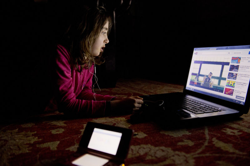 A girl watches a video on youtube.