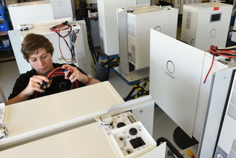 A worker assembling a Sonnen battery.