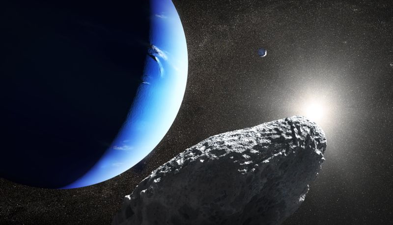 A picture of a small, rocky body with Neptune in the background