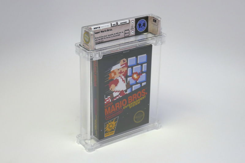 A boxed NES game in a clear container.