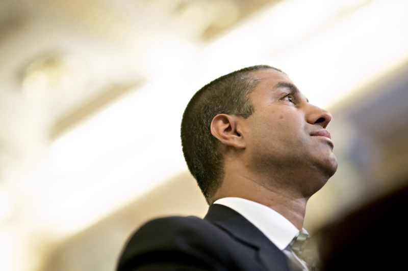 FCC Chairman Ajit Pai seen from the side as he listens during a Senate committee hearing.