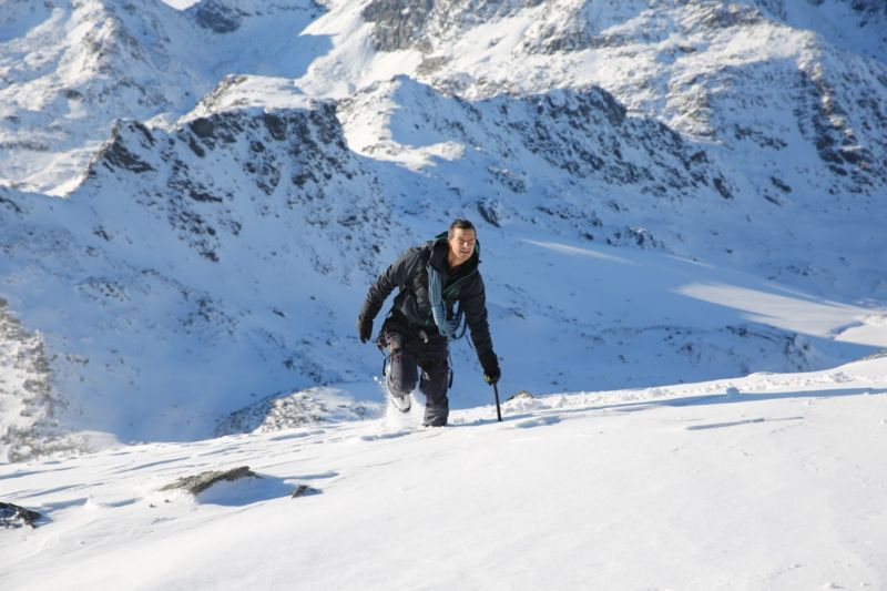 """This is not your mother's natural history series."" Host Bear Grylls filming in the Swiss Pennine Alps for the ""Mountains"" episode of National Geographic's new series, <em>Hostile Planet</em>."
