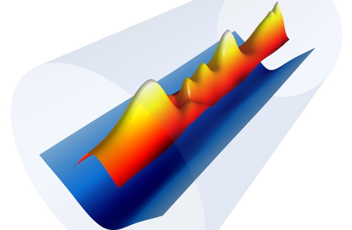 Snapshot of the plasma channel electron density profile (blue) formed inside a capillary (gray) with the combination of an electrical discharge and a 9ns laser pulse (red/yellow).
