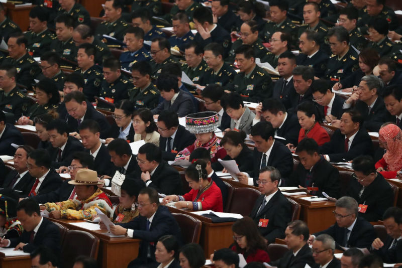 Deputies of the 13th National People's Congress listen to Chinese Premier Li Keqiang's speech during the opening of the Two Sessions at The Great Hall of People on March 5, 2019 in Beijing, China.