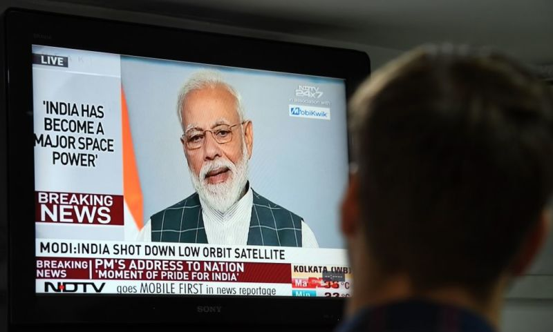 Indian Prime Minister Narendra Modi addresses the nation on a local news channel in New Delhi on March 27.