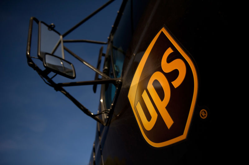 A United Parcel Service Inc. (UPS) logo is displayed on the door of a truck
