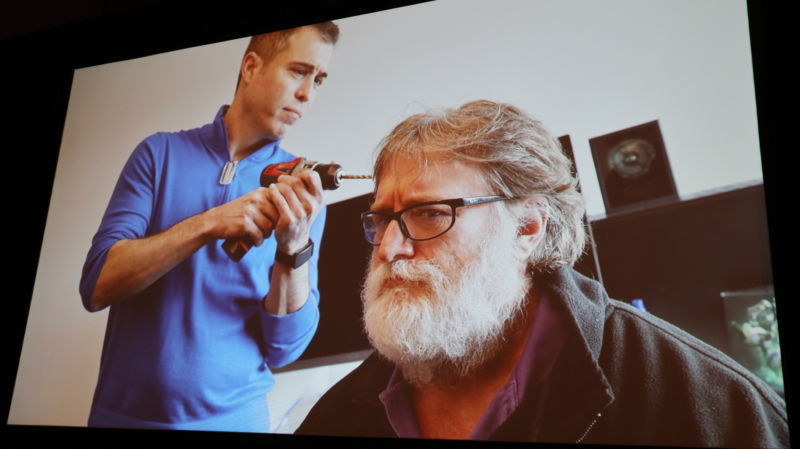 Valve Software's Mike Ambinder offers a joking photo of what people think his job as Principal Experimental Psychologist looks like. Valve co-founder Gabe Newell was not on hand to confirm or deny Valve's use of power tools on his head.