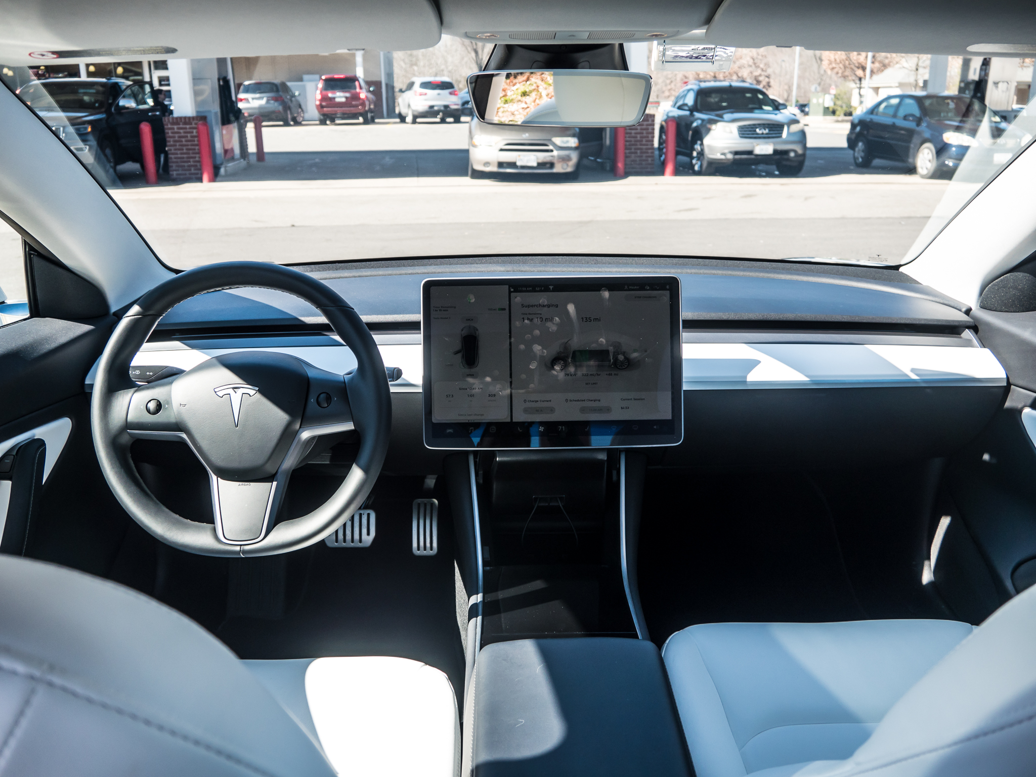 The interior of the Model 3 Performance is not really in keeping with a car that has a sticker price as optioned of almost $70,000. But take away the too-white pleather, the power seats, and the finicky console lids, and I think it's more than adequate for a $35,000 EV this good.