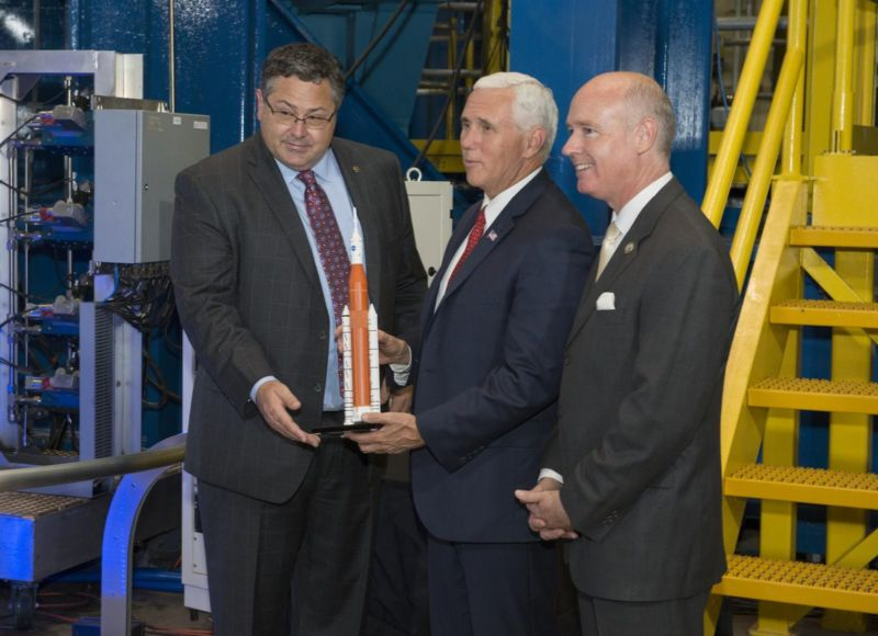 Then-director of the Marshall Space Flight Center Todd May (left) presents Vice President Mike Pence (center) with a Space Launch System model. Congressman Robert Aderholt (R-Ala.) stands at right.