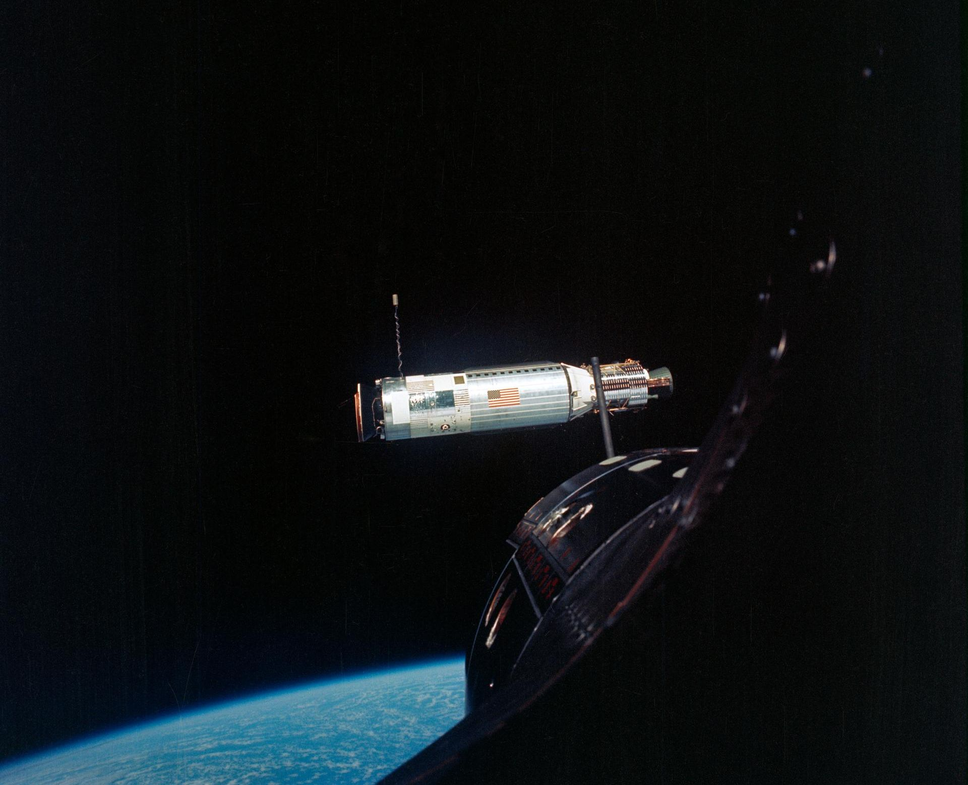 The Agena Target Docking Vehicle is photographed from the Gemini-10 spacecraft during rendezvous in space. They are 41 feet (about 12.5 meters) apart.
