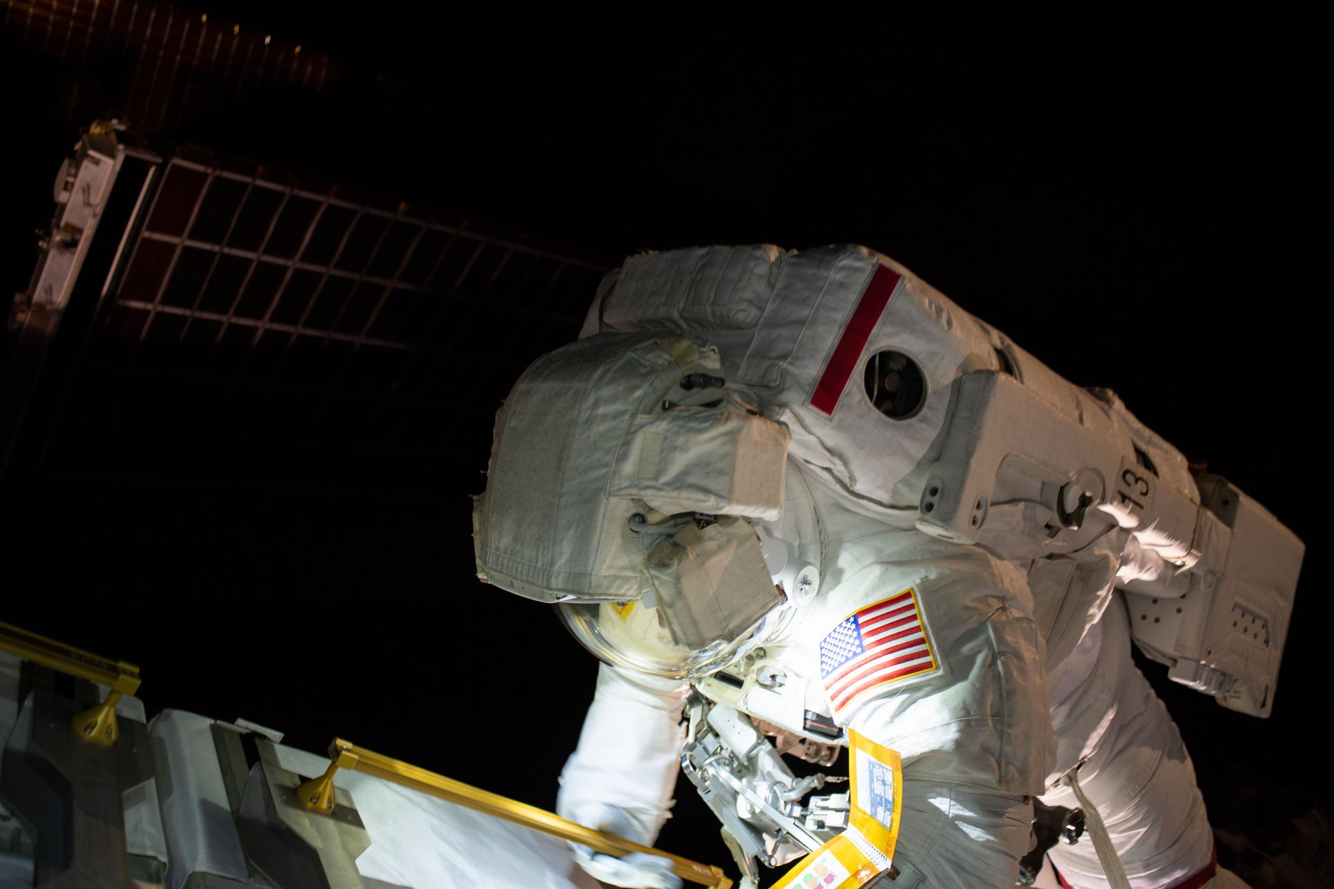 On March 22, Anne McClain works on the International Space Station's Port-4 truss structure during a 6-hour, 39-minute spacewalk.