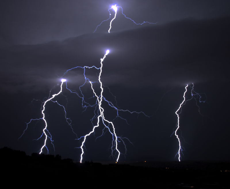 Lightning blazes across the night sky.