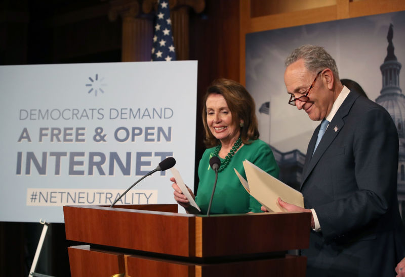 WASHINGTON, DC - MAY 16: Senate Democratic leader Charles Schumer (D-NY), with House Democratic leader Nancy Pelosi (D-CA) looking on, speaks at a press conference at the Capitol Building on May 16, 2018 in Washington, DC. The Senate voted and passed a Resolution of Disapproval to undo President Trump and FCC Chairman Ajit Pai's repeal of net neutrality rules.