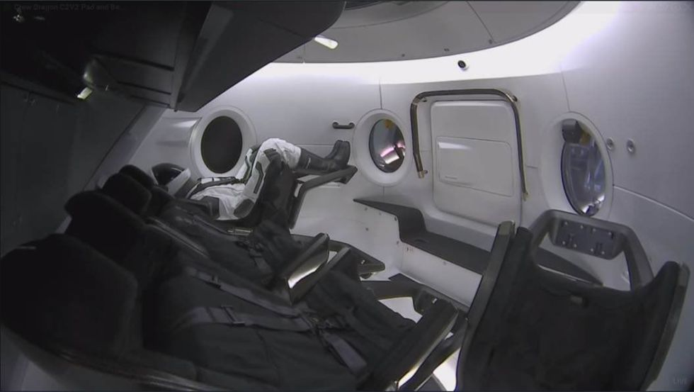 A view of the mannequin, Ripley, inside the Crew Dragon spacecraft.