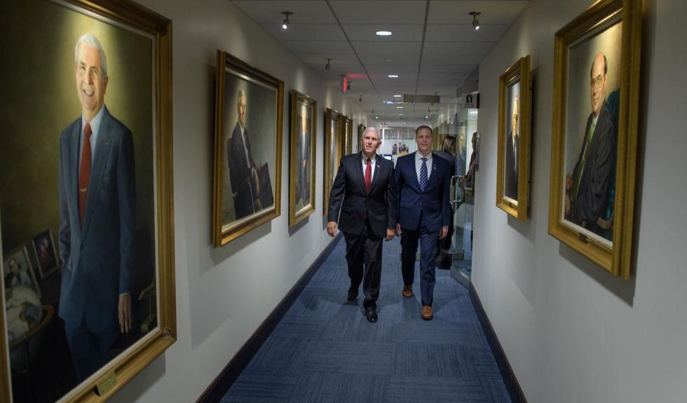 Vice President Mike Pence, left, and NASA Administrator Jim Bridenstine walk through NASA Headquarters in 2018.