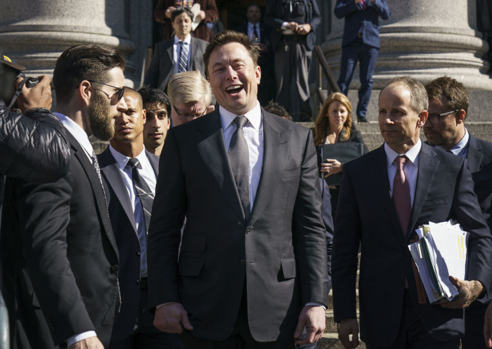 Elon Musk exits federal court on April 4, 2019 in New York City. He might be laughing at a Jeff Bezos meme.